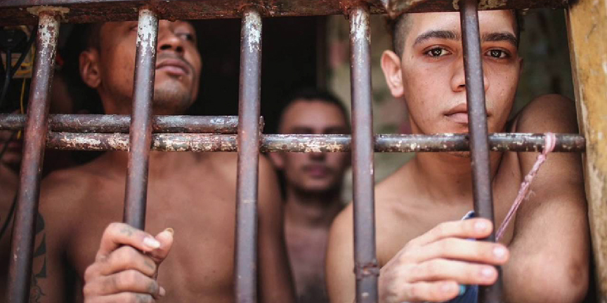 Young prisoners behind bars in a Brazilian prison