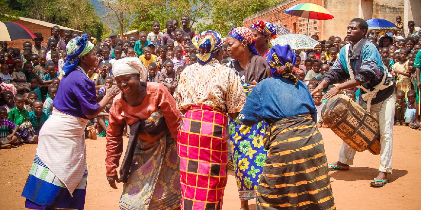 Yao women in Malawi dance in front of a crowd