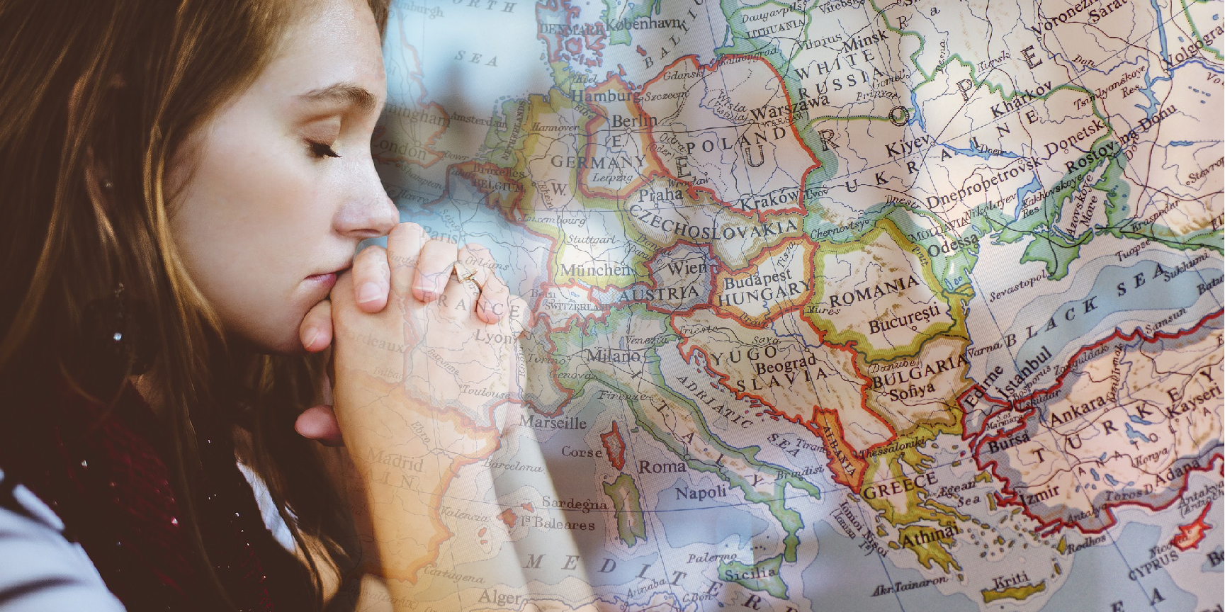 A woman praying and a map of Europe