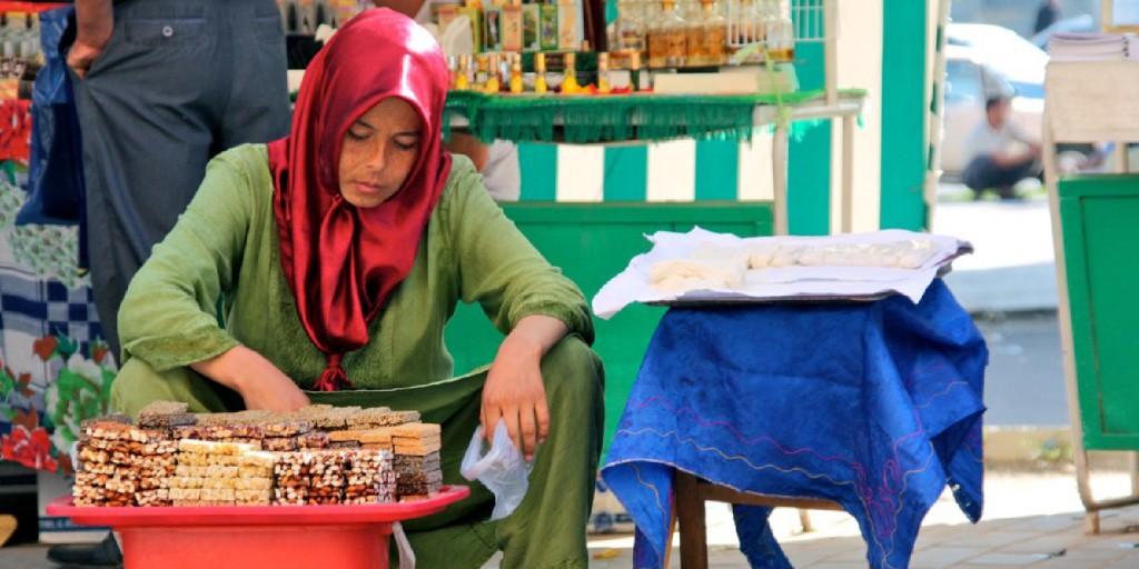 A woman tends a market stall