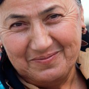 A woman wearing a colourful headscarf