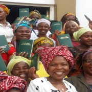 A group of women in Mozambique hold up their new Bibles