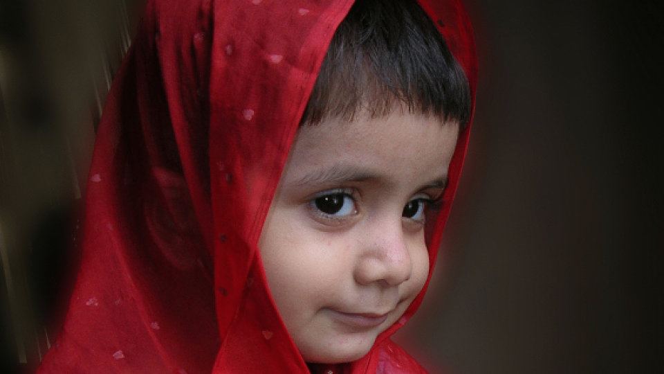 A young child in a headscarf